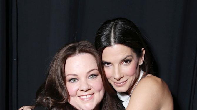 """Melissa McCarthy and Sandra Bullock, cast members in the upcoming film """"The Heat"""" at the 20th Century Fox Presentation at 2013 CinemaCon, on Thursday, April, 18th, 2013 in Las Vegas. (Photo by Eric Charbonneau/Invision for 20th Century Fox/AP Images)"""