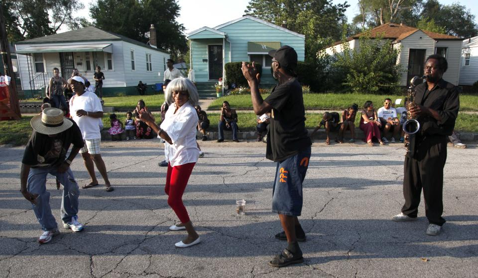 Gary Ind., residents dance to recorded music outside Jackson's boyhood home during celebrations marking what would have been Jackson's 54th birthday Wednesday, Aug. 29, 2012, in Gary. (AP Photo/Charles Rex Arbogast)