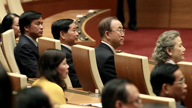 United Nations Secretary-General Ban Ki-moon and his wife Soon-taek attend a session of Vietnam's National Assembly (Parliament) in Hanoi