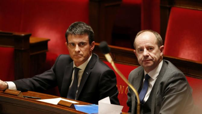 French Prime Minister Manuel Valls and Justice Minister Jean-Jacques Urvoas attend a vote on a constitutional reform bill at the National Assembly in Paris