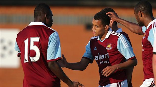 West Ham United's Ravel Morrison (centre) is congratulated on scoring the opening goal of the game