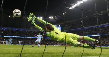 Manchester City's Aguero scores a goal on penalty against Bayern Munich's Neuer during their Champions League Group E soccer match in Manchester