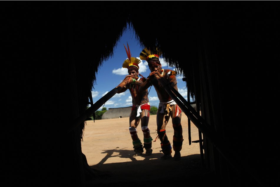 Yawalapiti men play the urua bamboo flute in the Xingu National Park