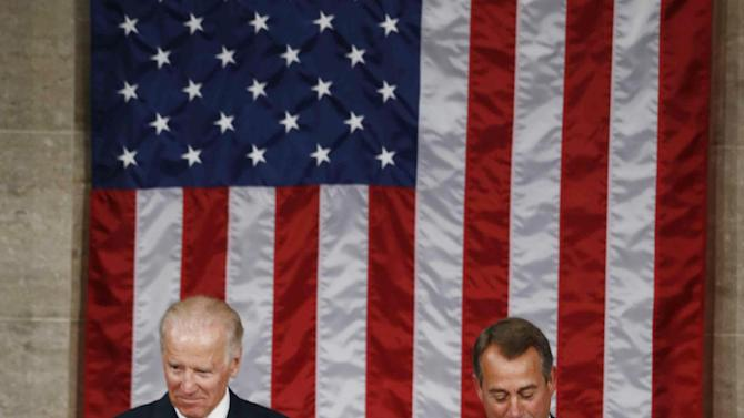 South Korea's President Park Geun-hye bows before she addresses a joint session of Congress on Capitol Hill in Washington, Wednesday, May 8, 2013. At rear are Vice President Joe Biden, left, and House Speaker John Boehner of Ohio. (AP Photo/Charles Dharapak)