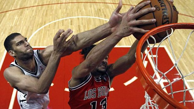 Chicago Bulls' Joakim Noah (R) grabs a rebound from Brooklyn Nets' Brook Lopez during the first half of their NBA basketball game in Chicago, Illinois (Reuters)