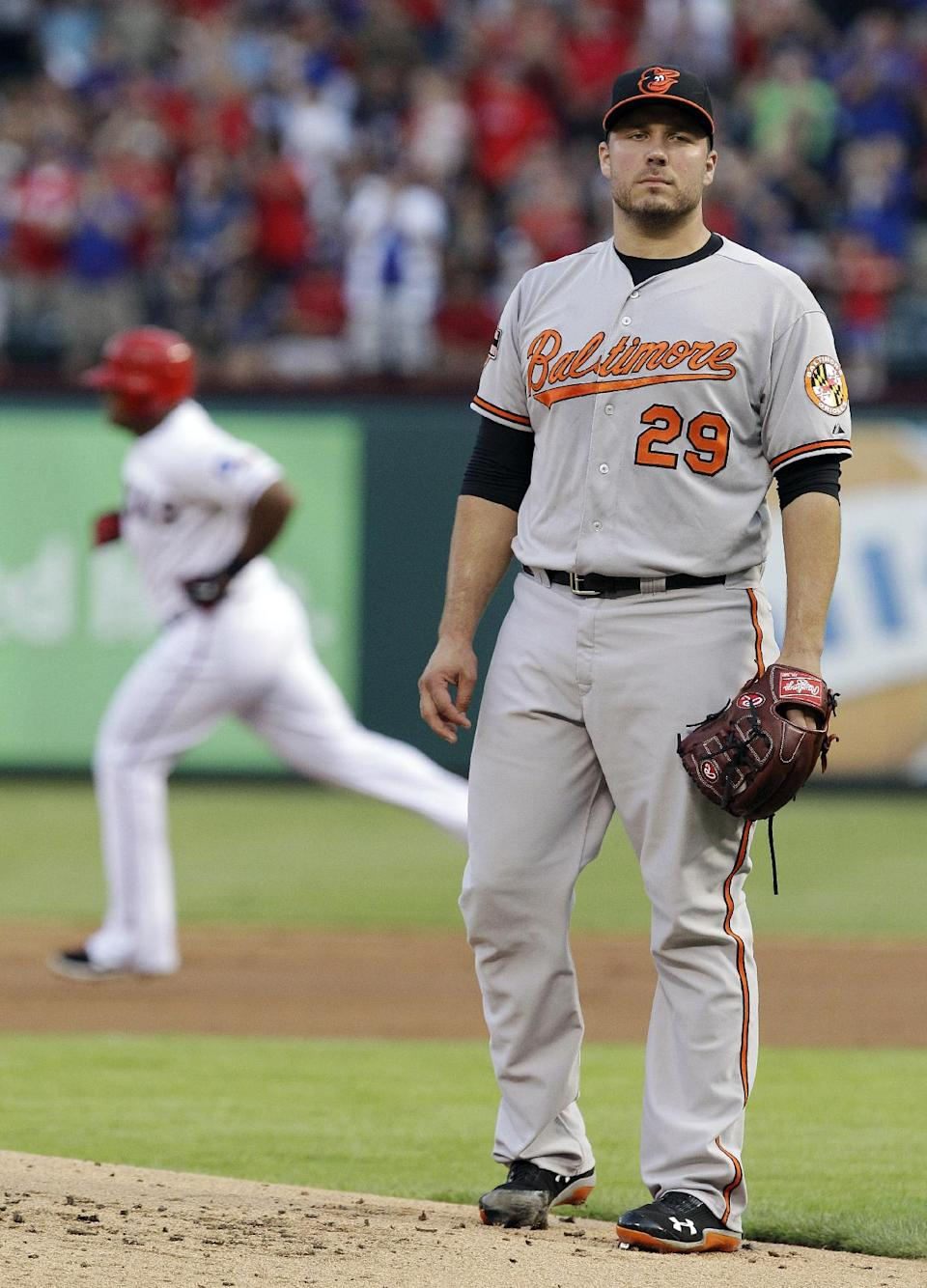 Baltimore Orioles starting pitcher Tommy Hunter (29) stands on the mound as Texas Rangers' Adrian Beltre rounds the bases after his solo home run during the second inning of a baseball game, Wednesday, Aug. 22, 2012, in Arlington, Texas. (AP Photo/LM Otero)