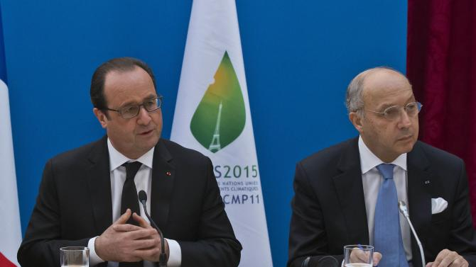 French President Francois Hollande and French Foreign Minister Laurent Fabius attend a France-Oceania summit at the Elysee Palace in Paris