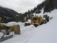 Crews work to plow Sylvan Pass, the highest point along the east entrance road into Yellowstone National Park in this April 2011 National Park Service handout photo obtained by Reuters March 2, 2013. REUTERS/National Park Service/Handout.