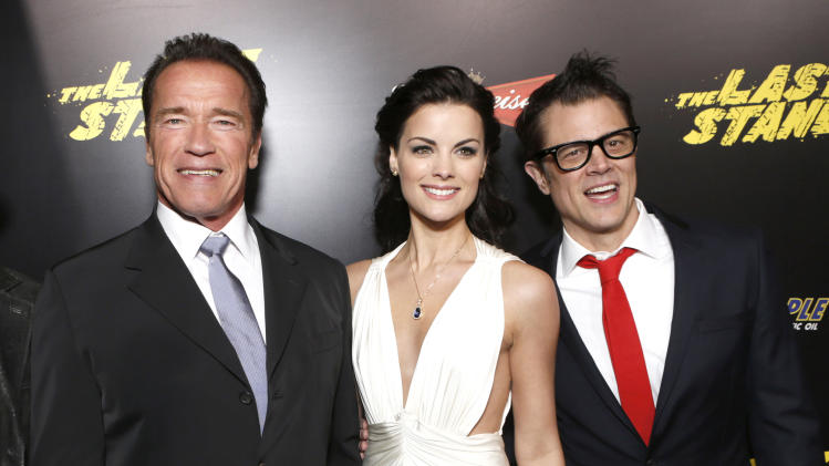 "Arnold Schwarzenegger, Jaime Alexander and Johnny Knoxville attend the LA premiere of ""The Last Stand"" at Grauman's Chinese Theatre on Monday, Jan. 14, 2013, in Los Angeles. (Photo by Todd Williamson/Invision/AP)"
