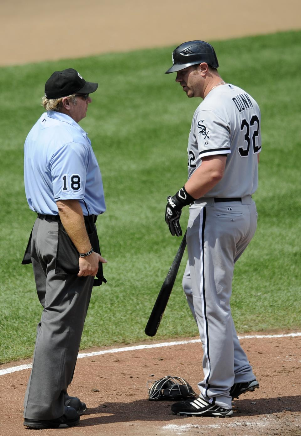 Chicago White Sox designated hitter Adam Dunn (32) looks at home plate umpire Brian Runge (18) after he struck out during the third inning of a baseball game against the Baltimore Orioles, Thursday, Aug. 30, 2012, in Baltimore. (AP Photo/Nick Wass)