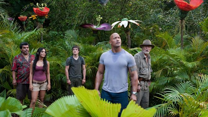 """In this image released by Warner Bros. Pictures, from left,  Luis Guzman, Vanessa Hudgens, Josh Hutcherson, Dwayne Johnson and Michael Caine are shown in a scene from """"Journey 2: The Mysterious Island."""" (AP Photo/Warner Bros. Pictures, Ron Phillips)"""