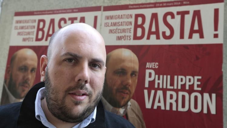 Philippe Vardon, president of the French far-right group Nissa Rebela, is seen in front of his campaign poster in Nice