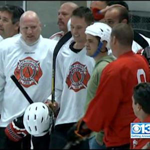 Firefighters' Hockey Game Benefits Firefighter With Brain Injury