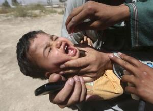 File picture shows a boy receiving polio vaccination drops during an anti-polio campaign in Kabul