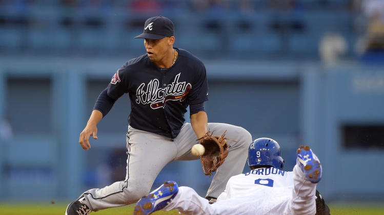 Los Angeles Dodgers' Dee Gordon, right, is caught stealing second by Atlanta Braves shortstop Andrelton Simmons during the third inning of a baseball game, Wednesday, July 30, 2014, in Los Angeles. (AP Photo/Mark J. Terrill)