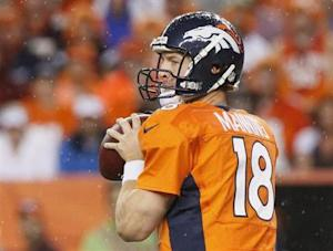 Denver Broncos' Peyton Manning looks to pass against the Baltimore Ravens during their NFL football game in Denver