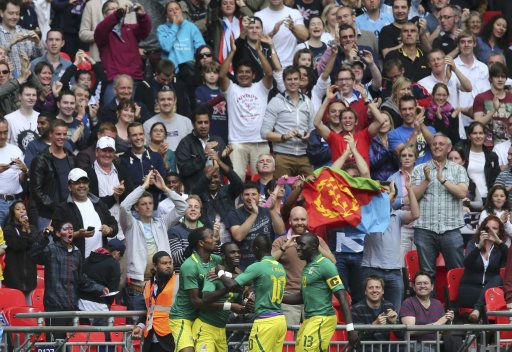 Senegal's Moussa Konate celebrates his goal against Uruguay with team mates during their men's preliminary first round Group A soccer match against Uruguay at the London 2012 Olympic Games in the Wembley Stadium in London