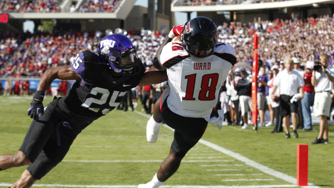 Texas Tech wide receiver Eric Ward catches a touchdown pass against TCU cornerback Kevin White (25) during the first half of an NCAA college football game, Saturday, Oct. 20, 2012, in Fort Worth, Texas. (AP Photo/LM Otero)