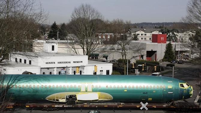 Boeing 737 fuselages are delivered by train to a Boeing manufacturing site in Renton, Washington