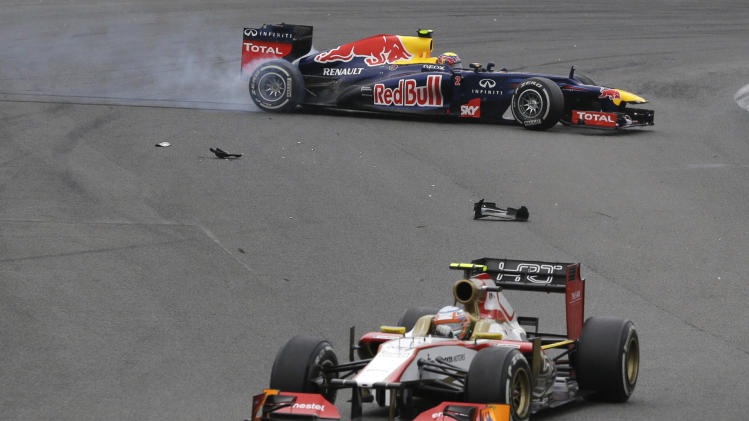 Red Bull driver Mark Webber of Australia, back, steers his car after colliding during the Formula One Brazilian Grand Prix at the Interlagos race track in Sao Paulo, Brazil, Sunday, Nov. 25, 2012. (AP Photo/Ricardo Mazalan)