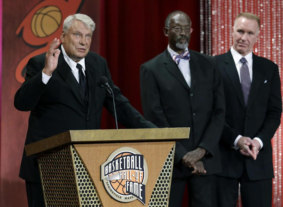 Inductee Don Nelson, left, speaks as Satch Sanders and Chris Mullin listen at right during the enshrinement ceremony for the 2012 class of the Naismith Memorial Basketball Hall of Fame at Symphony Hall in Springfield, Mass. Friday, Sept. 7, 2012. (AP Photo/Elise Amendola)