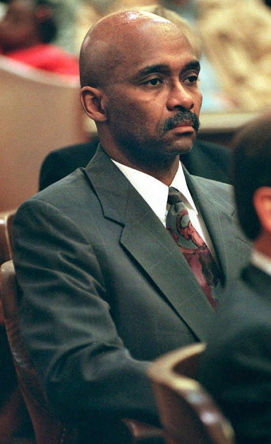 FILE - In this Sept. 23, 1998 file photo, former Akron, Ohio, police Capt. Douglas Prade shows no emotion as he is found guilty on all counts during his trial at the Summit County Common Pleas Court in Akron, Ohio. Court of Common Pleas Judge Judy Hunter on Tuesday, Jan. 29, 2013, ordered the 66-year-old Prade be set free based on new DNA test results that prove his innocence. Prade spent nearly 15 years in prison for his ex-wife's murder. (AP Photo/Ed Suba Jr., Pool, File)