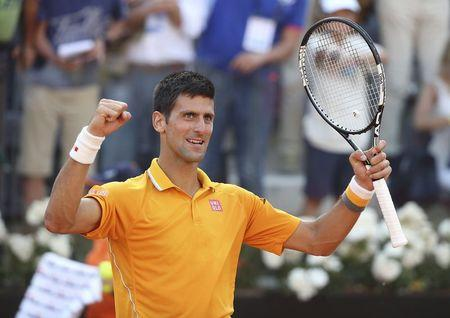 Djokovic of Serbia celebrates winning against Federer of Switzerland after their final match at the Rome Open tennis tournament in Rome