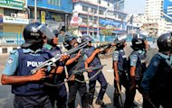 Bangladeshi police fire rubber bullets at Islamist activists during a clash in Dhaka yesterday. Police fired live rounds today in fresh clashes with supporters of the country's largest Islamic party, whose leaders are standing trial for war crimes, killing two people