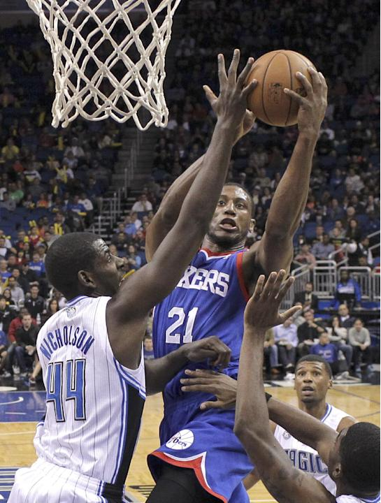 Philadelphia 76ers' Thaddeus Young (21) makes a shot over Orlando Magic's Andrew Nicholson (44) during the second half of an NBA basketball game in Orlando, Fla., Wednesday, Nov. 27, 2013. Orlando won
