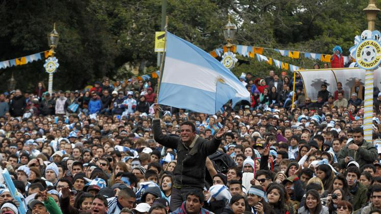 Argentina soccer fans gather in a public square in Buenos Aires, to watch the team's World Cup soccer match against Iran