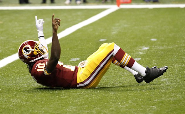 Washington Redskins quarterback Robert Griffin III (10) reacts after throwing a touchdown pass in the first quarter of an NFL football game against the New Orleans Saints at Mercedes-Benz Superdome in
