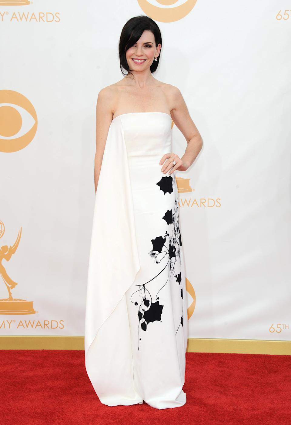 Julianna Margulies arrives at the 65th Primetime Emmy Awards at Nokia Theatre on Sunday Sept. 22, 2013, in Los Angeles. (Photo by Jordan Strauss/Invision/AP)