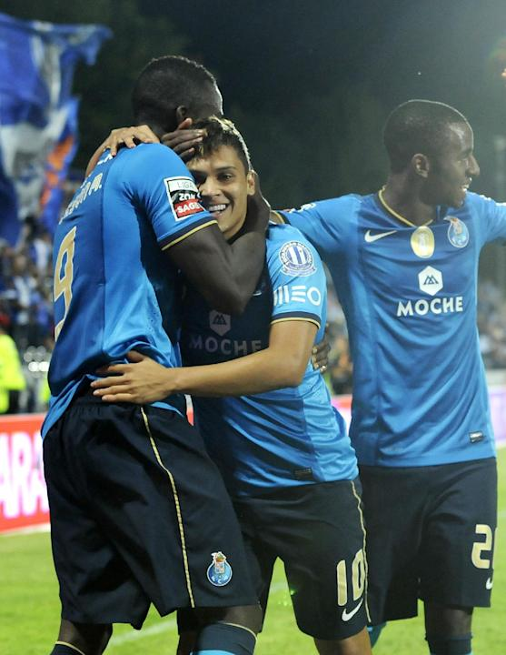 FC Porto's Juan Quintero, centre, celebrates with Jackson Martinez, both from Colombia, and Ricardo Pereira, right, after scoring from a free kick against Arouca during their Portuguese League soccer