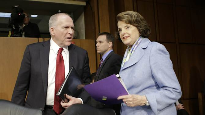 FILE - In this Feb. 7, 2013 file photo, Senate Intelligence Committee Chair Sen. Dianne Feinstein, D-Calif., right, welcomes CIA Director nominee John Brennan on Capitol Hill in Washington, prior to the start of Brennan's confirmation hearing before the committee. Lawmakers are considering whether Congress can set up a court to decide when drones can kill U.S. citizens overseas, much like the secret courts that now grant permission for surveillance. It's another sign of the U.S. philosophical struggle over remote warfare, raised after CIA head nominee John Brennan's vigorous defense of the drones. (AP Photo/J. Scott Applewhite, File)
