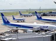 Passenger planes from All Nippon Airways (ANA) sit parked on the tarmac at Tokyo's Haneda airport in August 2012. ANA said Wednesday half-year net profit soared 61.6 percent on solid travel demand although it admitted Tokyo's territorial spat with Beijing hurt its China business