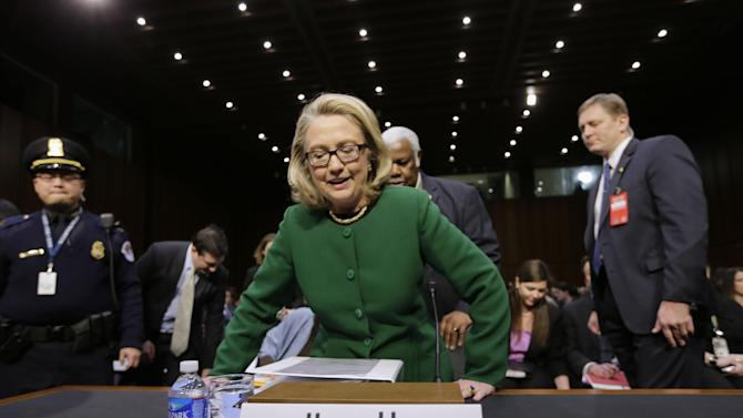 Secretary of State Hillary Rodham Clinton takes her seat on on Capitol Hill in Washington,  Wednesday, Jan. 23, 2013, prior to testifying before the Senate Foreign Relations Committee hearing on the deadly September attack on the U.S. diplomatic mission in Benghazi, Libya, that killed Ambassador Chris Stevens and three other Americans.  (AP Photo/J. Scott Applewhite)