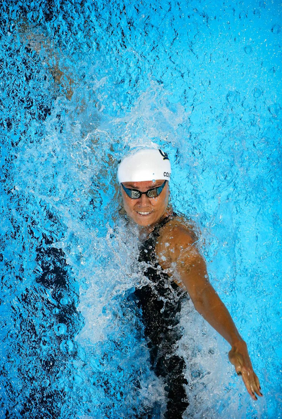 Natalie Coughlin swims in the women's 100-meter backstroke preliminaries at the U.S. Olympic swimming trials, Tuesday, June 26, 2012, in Omaha, Neb. (AP Photo/Mark Humphrey)