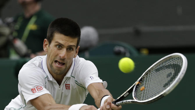 Novak Djokovic of Serbia plays a shot to Roger Federer of Switzerland during a semifinals match at the All England Lawn Tennis Championships at Wimbledon, England, Friday, July 6, 2012. (AP Photo/Anja Niedringhaus)