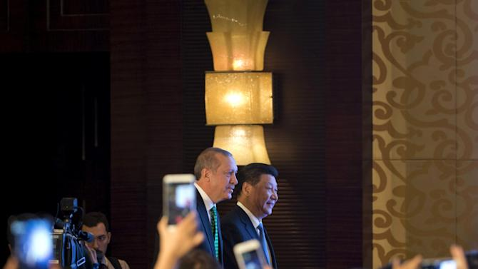 Chinese President Jinping and Turkey's President Erdogan arrive at the venue for the Turkey-China Business Forum in Beijing