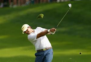International team player Jason Day of Australia hits a shot on the ninth hole during his Four-ball match at the 2013 Presidents Cup golf tournament at Muirfield Village Golf Club in Dublin, Ohio