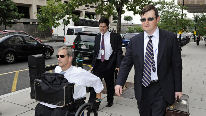 FILE - In this July 13,2011 file photo, Assistant U.S. Attorneys Daniel Butler, left, and Steve Durham, leave federal court  in Washington. On a baseball field, players back up teammates to limit the damage from errors. The Justice Department, embarrassed by an error that caused a mistrial of Roger Clemens last year, has added more prosecutors in hopes of containing any missteps as it seeks to convict the famed pitcher of lying to Congress when he said he never used performance-enhancing drugs.  (AP Photo/Cliff Owen, File)