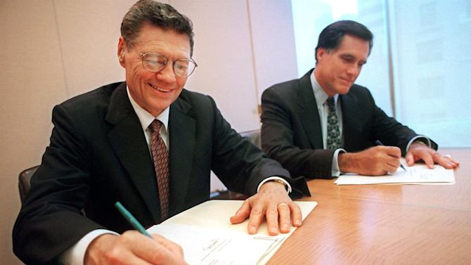 """FILE - In this Sept. 25, 1998 file photo, provided by Domino's Pizza, Thomas Monaghan, founder and chairman of Domino's Pizza, Inc., left, and Mitt Romney, managing director of Bain Capital, Inc., sign an agreement for Monaghan to sell a """"significant portion"""" of his stake in the company to Bain Capital, in New York. A businessman at his core, Mitt Romney was legendary in the private sector for his reliance on reams of information and extensive research to decide which companies to take over. And, when interviewing potential employees, he favored question-and-answer sessions designed to make recruits think on their feet and provide clues about how they approached situations.  (AP Photo/Domino's Pizza, Scott Gries, File)"""
