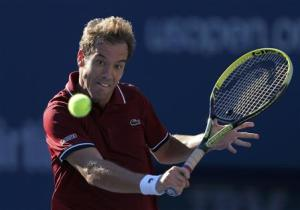 Gasquet of France hits a return to Ferrer of Spain at the U.S. Open tennis championships in New York