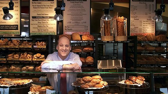FILE - In this May, 2002 file photo Panera Bread Co. CEO Ron Shaich stands behind a counter in a St. Louis cafe.  Three years after launching its pioneering pay what you want cafe, the suburban St. Louis-based chain on Wednesday quietly began its latest charitable venture that takes the concept on a trial run to all 48 cafes in the St. Louis region. Cafes will offer a bowl of turkey chili for which customers will set their own price. (AP Photo/Tom Gannam, File)
