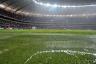 Water covers the grass at the stadium in Warsaw. Heavy rain in Warsaw on Tuesday forced the postponement of Poland's 2014 World Cup qualifier against England