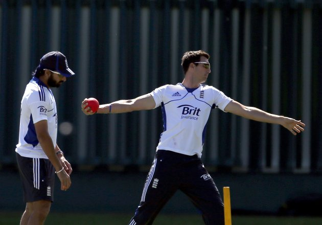 England cricket team player Panesar watches as team mate Finn bowls a large ball during a training session at the University Oval in Dunedin