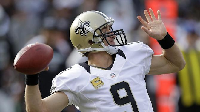 New Orleans Saints quarterback Drew Brees drops back to pass during the second quarter of an NFL football game against the Oakland Raiders in Oakland, Calif., Sunday, Nov. 18, 2012. (AP Photo/Ben Margot)