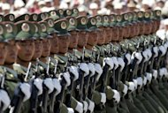 Chinese soldiers take part in a 2004 military parade to mark the establishment of a miltary barracks in Hong Kong. China has appointed military officers at a newly-established garrison in the South China Sea, the country&#39;s latest step to bolster claims to disputed islands in the area