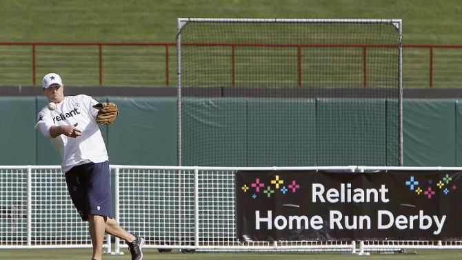 IMAGE DISTRIBUTED FOR RELIANT - Dallas Cowboys' Jason Witten throws a ball back during the Home Run Derby Competition hosted by Reliant to benefit The Salvation Army on Wednesday, May 8, 2013 in Arlington, Texas. (Brandon Wade/AP Images for Reliant)
