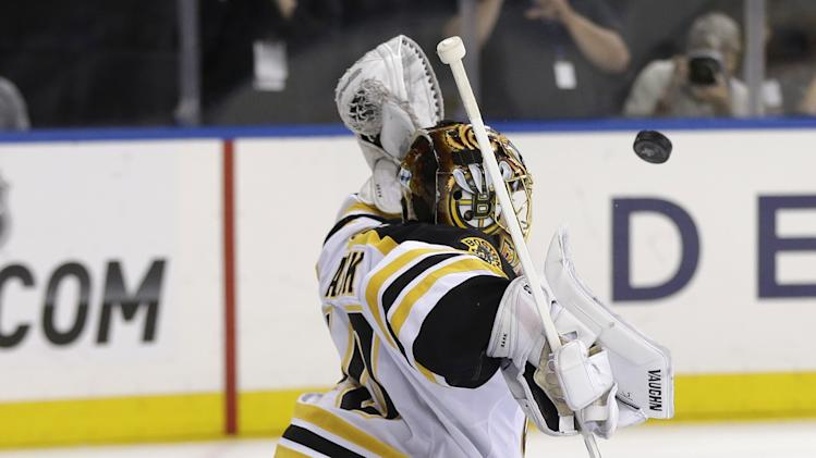 Boston Bruins goalie Tuukka Rask blocks a shot during the second period in Game 4 of the Eastern Conference semifinals against the New York Rangers in the NHL hockey Stanley Cup playoffs in New York, Thursday, May 23, 2013, in New York. (AP Photo/Seth Wenig)